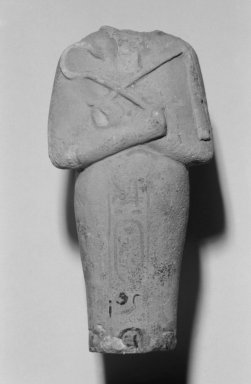 <em>Fragment of a Shabti of Akhenaten</em>, ca. 1352-1336 B.C.E. Faience, 5 1/2 x 2 13/16 x 1 3/8 in. (13.9 x 7.1 x 3.5 cm). Brooklyn Museum, Charles Edwin Wilbour Fund, 35.1878. Creative Commons-BY (Photo: Brooklyn Museum, 35.1878_bw.jpg)