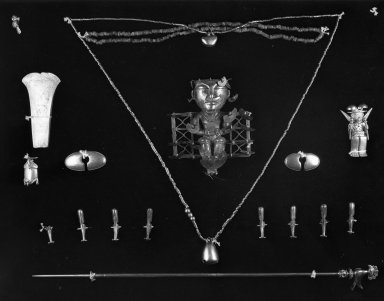 <em>Twenty-four Copper Pieces of a Necklace in the Form of a Legless Animal</em>. Copper Brooklyn Museum, Alfred W. Jenkins Fund, 35.191a-x. Creative Commons-BY (Photo: Brooklyn Museum, 35.191a-x_acetate_bw.jpg)