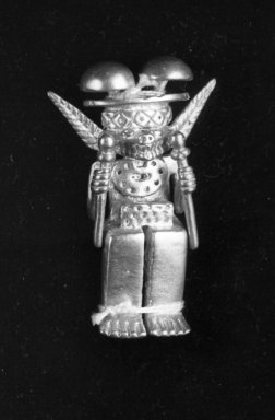 <em>Gold Idol Seated Holding a Sceptre in Each Hand with Double Mushroom Headdress</em>. Gold, 2 5/8in. (6.7cm). Brooklyn Museum, Alfred W. Jenkins Fund, 35.195. Creative Commons-BY (Photo: Brooklyn Museum, 35.195_acetate_bw.jpg)
