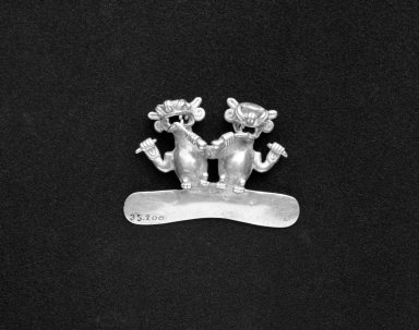 <em>Ornament in the Form of Two Monkeys</em>. Gold, 1 9/16 x 2 5/16in. (4 x 5.8cm). Brooklyn Museum, Alfred W. Jenkins Fund, 35.200. Creative Commons-BY (Photo: Brooklyn Museum, 35.200_bw.jpg)