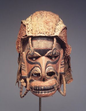 <em>Mask (Tatanua)</em>, 19th century. Wood, rattan, barkcloth, fiber, seeds, sea sponge, tapestry turban snail (Turbo petholatus) opercula, pigment, 13 × 14 × 10 in. (33 × 35.6 × 25.4 cm). Brooklyn Museum, Gift of Russell Sturgis, 35.2212. Creative Commons-BY (Photo: Brooklyn Museum, 35.2212_transp6191.jpg)