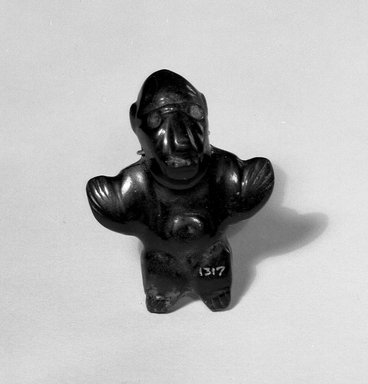 <em>Figurine</em>. Jade, 2 5/16 x 1 3/4 in. (5.8 x 4.5 cm). Brooklyn Museum, Alfred W. Jenkins Fund, 35.548. Creative Commons-BY (Photo: Brooklyn Museum, 35.548_view1_acetate_bw.jpg)
