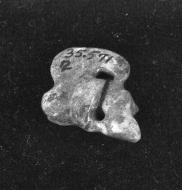 <em>Pendant</em>. Jade Brooklyn Museum, Alfred W. Jenkins Fund, 35.571. Creative Commons-BY (Photo: Brooklyn Museum, 35.571_acetate_bw.jpg)