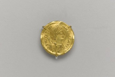 Byzantine. <em>Coin: Tremissis of Justinian the Great</em>, 527-565 C.E. Gold, 1/16 x 9/16 in. Diam. (0.2 x 1.5 cm). Brooklyn Museum, Frank L. Babbott Fund and Henry L. Batterman Fund, 36.155. Creative Commons-BY (Photo: Brooklyn Museum, 36.155.at_front_PS1.jpg)