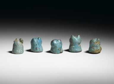 <em>Lion-Headed Gaming Piece, 1 of 5</em>, ca. 1938-1630 B.C.E. Faience, 3/4 x 13/16 in. (1.9 x 2.1 cm). Brooklyn Museum, Charles Edwin Wilbour Fund, 36.3.3. Creative Commons-BY (Photo: , 36.3.1_36.3.2_36.3.3_36.3.4_36.3.5_back_PS2.jpg)