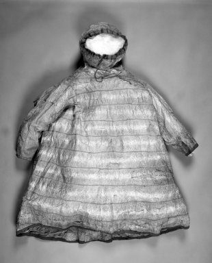 Inupiaq Eskimo. <em>Raincoat with a Drawstring Hood, edged in blue fabric</em>. Seal Intestine, cloth, thread, fiber, 46 1/2 x 36 1/2 in. or (132.0 x 101.0 cm). Brooklyn Museum, Frank L. Babbott Fund, 36.30. Creative Commons-BY (Photo: Brooklyn Museum, 36.30_bw.jpg)