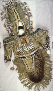 Inupiaq Eskimo. <em>Woman's Beaded and Fringed Wedding Dress</em>, 1900-1930. Caribou hide, caribou teeth, wood, beads, 63 x 29 in. (160 x 73.7 cm). Brooklyn Museum, Frank L. Babbott Fund, 36.31. Creative Commons-BY (Photo: Brooklyn Museum, 36.31.jpg)