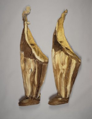 Inupiaq Eskimo. <em>Pair of Boots</em>, ca. 1900. Caribou skin, fur, a (approximate): 45 x 15 in. (114.3 x 38.1 cm). Brooklyn Museum, Frank L. Babbott Fund, 36.32a-b. Creative Commons-BY (Photo: Brooklyn Museum, 36.32a-b.jpg)
