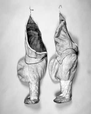 Inupiaq Eskimo. <em>Woman's Pair of Leggings/Boots</em>, 1900-1930. Caribou skin, each: 41 x 14 in. (104.1 x 35.6 cm). Brooklyn Museum, Frank L. Babbott Fund, 36.33a-b. Creative Commons-BY (Photo: Brooklyn Museum, 36.33a-b_bw.jpg)