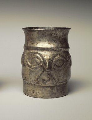 Chimú Inca. <em>Beaker in the Form of a Man's Head</em>, 1400-1532. Silver, 3 × 2 × 2 3/4 in. (7.6 × 5.1 × 7 cm). Brooklyn Museum, Gift of Mrs. Eugene Schaefer, 36.358. Creative Commons-BY (Photo: Brooklyn Museum, 36.358.jpg)