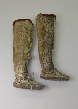 Inupiaq Eskimo. <em>Man's Pair of Thigh-high Boots with red fabric decoration</em>, 1900-1930. Sealskin, wool, cloth, yarn, each ca. 29 x 11 1/2 x 5 3/4 in. or (80.5 x 28.5 cm). Brooklyn Museum, Frank L. Babbott Fund, 36.37a-b. Creative Commons-BY (Photo: Brooklyn Museum, 36.37a-b_PS5.jpg)