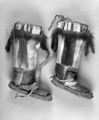 Inupiaq Eskimo. <em>Pair of Boots with tassels at the front and back and drawstring tops</em>, 1900-1930. Caribou hide, Canadian Lynx fur, a: 15 1/2 x 10 1/4 x 3 1/2 in. or (39.0 x 28.0 cm). Brooklyn Museum, Frank L. Babbott Fund, 36.38a-b. Creative Commons-BY (Photo: Brooklyn Museum, 36.38a-b_bw.jpg)