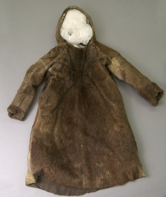 Inupiaq Eskimo. <em>Man's Parka with tasseled drawstring Hood</em>, 1900-1930. Fur, hide, string, yarn, 56 x 35 1/2 in. or (143.0 x 84.0). Brooklyn Museum, Frank L. Babbott Fund, 36.39. Creative Commons-BY (Photo: Brooklyn Museum, 36.39_front_PS5.jpg)