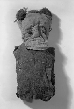 Chancay. <em>Figural Sculpture</em>, 1000-1532. Cotton, camelid fiber, plant seed, furcraea(?), 13 3/8 x 5 1/2 x 2 3/4 in. (34 x 14 x 7 cm). Brooklyn Museum, Gift of Mrs. Eugene Schaefer, 36.406. Creative Commons-BY (Photo: Brooklyn Museum, 36.406_front_acetate_bw.jpg)