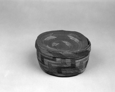 Northwest Coast. <em>Basket and Lid with geometric designs</em>, late 19th-early 20th century. Straw, 8 x 4 in. or (10.0 x 19.0 cm). Brooklyn Museum, Gift of Frederic B. Pratt, 36.516a-b. Creative Commons-BY (Photo: Brooklyn Museum, 36.516a-b_bw.jpg)