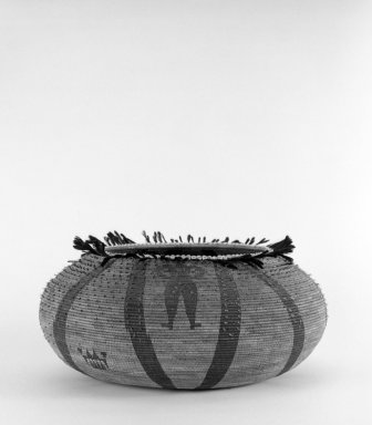 Pomo. <em>Large Basket made with the 'shi-bu' technique and decorated with woven design of a man</em>, 19th century. Bead, feather, willow, bark or root thread, 4 1/4 x (dia) 11 1/8 in. or (12.5 x 17.5 cm). Brooklyn Museum, Gift of Frederic B. Pratt, 36.519. Creative Commons-BY (Photo: Brooklyn Museum, 36.519_bw.jpg)