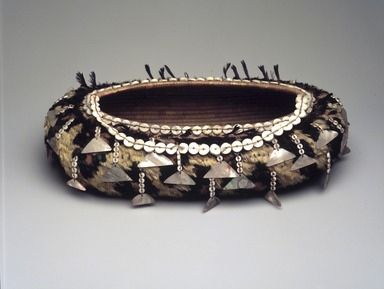 Pomo. <em>Oblong-shaped Basket</em>, late 19th or early 20th century. Fiber, beads, feathers, mother of pearl, 2 15/16 x 12 x 7 in. (7.5 x 30.5 x 17.8 cm). Brooklyn Museum, Gift of Frederic B. Pratt, 36.523. Creative Commons-BY (Photo: Brooklyn Museum, 36.523_transp6356.jpg)