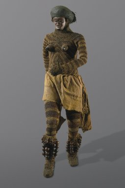 Luvale. <em>Likishi Dance Costume Shirt and Head Cover with Pwo Mask</em>, late 19th or early 20th century. Fiber, wood, seedpods, hide, metal, 40 1/2 x 8 1/2 in.  (102.9 x 21.6 cm). Brooklyn Museum, Museum Collection Fund, 36.548. Creative Commons-BY (Photo: Brooklyn Museum, 36.548_36.549_36.550a-b_36.551a-b_36.552_36.553_front_installation_edited_SL1.jpg)