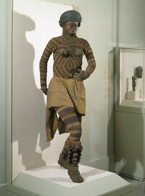 Luvale. <em>Likishi Dance Costume Leggings</em>, late 19th or early 20th century. Bark, rope, 41 x 25 1/4 in.  (104.1 x 64.1 cm). Brooklyn Museum, Museum Collection Fund, 36.549. Creative Commons-BY (Photo: Brooklyn Museum, 36.548_36.549_36.550a-b_36.551a-b_36.552_36.553_threequarter_installation_SL1.jpg)