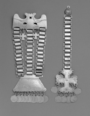 Mapuche. <em>Woman's Breast Ornaments</em>, late 19th-early 20th century. Silver, a:  11 x 4 3/16 in. (27.9 x 10.6 cm.). Brooklyn Museum, Ella C. Woodward Memorial Fund, 36.929a-b. Creative Commons-BY (Photo: Brooklyn Museum, 36.929a-b_bw_SL1.jpg)