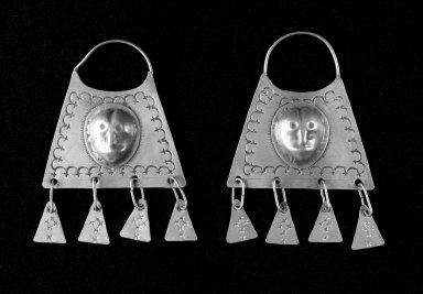 Mapuche. <em>Pair of Earrings</em>, 18th-19th century. Silver, a: 5 5/16 x 3 1/2 x 1/8 in. (13.5 x 8.9 x 0.3 cm.). Brooklyn Museum, Ella C. Woodward Memorial Fund, 36.931a-b. Creative Commons-BY (Photo: Brooklyn Museum, 36.931a-b_bw.jpg)
