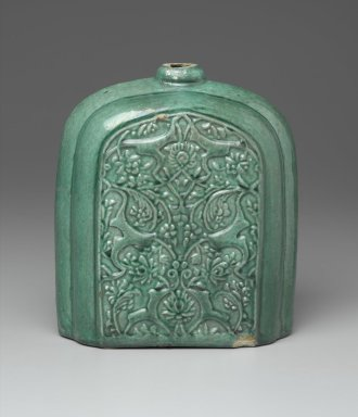<em>Pilgrim Flask</em>, early 17th century. Ceramic; earthenware, molded and covered with a green glaze, 8 11/16 x 6 11/16 x 4 1/8 in. (22 x 17 x 10.5 cm). Brooklyn Museum, Gift of Mr. and Mrs. Frederic B. Pratt, 36.942. Creative Commons-BY (Photo: Brooklyn Museum, 36.942_front_PS2.jpg)