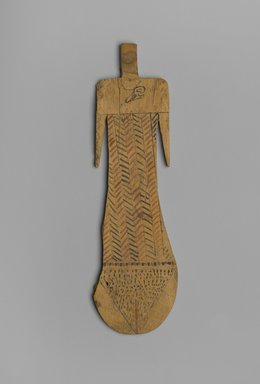 <em>Paddle Doll</em>, ca. 2008-1630 B.C.E. Wood, pigment, 8 5/16 x 2 7/16 x 3/16 in. (21.1 x 6.2 x 0.5 cm). Brooklyn Museum, Charles Edwin Wilbour Fund, 37.104E. Creative Commons-BY (Photo: Brooklyn Museum, 37.104E_front_PS2.jpg)