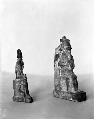 <em>Statue of Isis Holding the Child Horus</em>. Wood Brooklyn Museum, Charles Edwin Wilbour Fund, 37.1070E. Creative Commons-BY (Photo: , 37.1070E_37.1372E_GRPA_glass_bw.jpg)