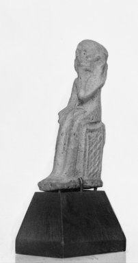 <em>Amulet of the Child Horus</em>, 664-30 B.C.E. Faience, 1 11/16 × 7/16 × 11/16 in. (4.3 × 1.1 × 1.8 cm). Brooklyn Museum, Charles Edwin Wilbour Fund, 37.1091E. Creative Commons-BY (Photo: Brooklyn Museum, 37.1091E_GRP-A_glass_bw_SL1.jpg)