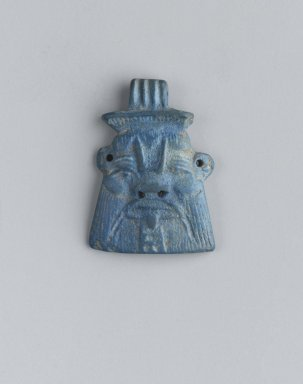 <em>Bes Head Amulet</em>, ca. 1075-656 B.C.E. Lapis lazuli, 1 3/16 x 7/8 x 1/4 in. (3 x 2.2 x 0.6 cm). Brooklyn Museum, Charles Edwin Wilbour Fund, 37.1100E. Creative Commons-BY (Photo: Brooklyn Museum, 37.1100E_front_PS2.jpg)