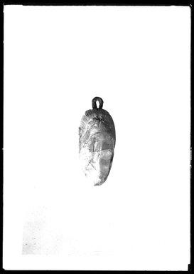 <em>Heart Amulet with Eyelet</em>, 305 B.C.E.-395 C.E. Quartz, bronze, 1 15/16 x 1 5/16 x 7/8 in. (4.9 x 3.3 x 2.3 cm). Brooklyn Museum, Charles Edwin Wilbour Fund, 37.1162E. Creative Commons-BY (Photo: Brooklyn Museum, 37.1162E_NegB_SL4.jpg)