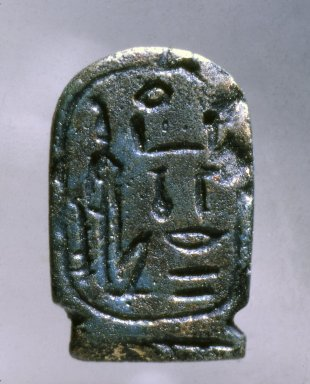 <em>Amulet in the Form of a Cartouche Hatshepsut</em>, ca. 1539-1353 B.C.E. Faience, 1 1/8 x 11/16 x 1/4 in. (2.8 x 1.8 x 0.6 cm). Brooklyn Museum, Charles Edwin Wilbour Fund, 37.1216E. Creative Commons-BY (Photo: Brooklyn Museum, 37.1216E.jpg)