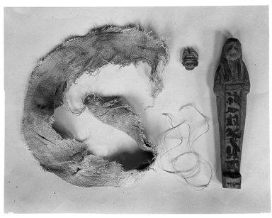 <em>Small Model of a Coffin with Two Ushabti of Seba</em>, ca. 1075-945 B.C.E. Wood, stone, linen, Sarcophagus length: 9 1/2 in. (24.1 cm). Brooklyn Museum, Charles Edwin Wilbour Fund, 37.126Ea-b. Creative Commons-BY (Photo: Brooklyn Museum, 37.126E_NegA1_glass_bw_SL4.jpg)