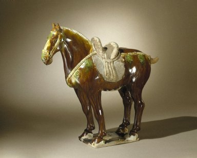 <em>Horse</em>, 618-907. Earthenware, brown and green lead glaze, 17 3/4 x 5 7/8 x 18 1/2 in. (45.1 x 15 x 47 cm). Brooklyn Museum, By exchange, 37.128. Creative Commons-BY (Photo: Brooklyn Museum, 37.128_SL1.jpg)