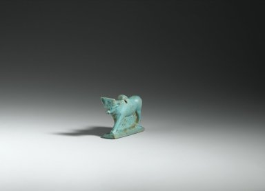 <em>Amulet Representing a Bull</em>, 664-332 B.C.E. Faience, 1 1/4 x 1/2 x 1 9/16 in. (3.2 x 1.2 x 4 cm). Brooklyn Museum, Charles Edwin Wilbour Fund, 37.1320E. Creative Commons-BY (Photo: Brooklyn Museum, 37.1320E_view1_PS2.jpg)