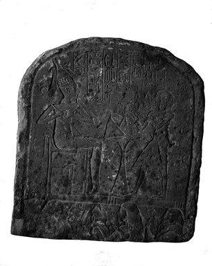 <em>Upper Part of Funerary Stela</em>. Limestone, gesso or plaster, 13 x 11 13/16 x 3 15/16 in. (33 x 30 x 10 cm). Brooklyn Museum, Charles Edwin Wilbour Fund, 37.1350E. Creative Commons-BY (Photo: Brooklyn Museum, 37.1350E_NegA_glass_bw_SL4.jpg)