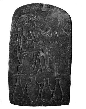 <em>Stela of Netjer-mose</em>, ca. 1539-1425 B.C.E. Limestone, 14 7/8 x 9 1/16 x 3 5/8in. (37.8 x 23 x 9.2cm). Brooklyn Museum, Charles Edwin Wilbour Fund, 37.1351E. Creative Commons-BY (Photo: Brooklyn Museum, 37.1351E_NegA_glass_bw.jpg)