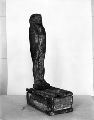 <em>Mummiform Figure of Osiris</em>, 305–30 B.C.E. Wood, plaster, pigment, Figure: 17 1/8 x 3 3/4 x 2 3/8 in. (43.5 x 9.5 x 6 cm). Brooklyn Museum, Charles Edwin Wilbour Fund, 37.1377E. Creative Commons-BY (Photo: Brooklyn Museum, 37.1377E_NegA_glass_bw_SL4.jpg)