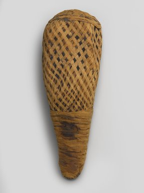 <em>Ibis Mummy</em>, 740-380 B.C.E. Animal remains (female sacred ibis, Threskiornis aethiopicus), linen, 16 × 5 3/4 × 4 3/4 in. (40.6 × 14.6 × 12.1 cm). Brooklyn Museum, Charles Edwin Wilbour Fund, 37.1382E. Creative Commons-BY (Photo: Brooklyn Museum, 37.1382E_PS9.jpg)