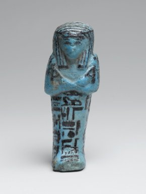 <em>Small Shabty of the Chief Draftsman Amen-em-opet</em>, ca. 1075-656 B.C.E. Faience, 4 1/8 x 1 9/16 x 1 7/16 in. (10.5 x 4 x 3.6 cm). Brooklyn Museum, Charles Edwin Wilbour Fund, 37.138E. Creative Commons-BY (Photo: Brooklyn Museum, 37.138E_front_PS2.jpg)