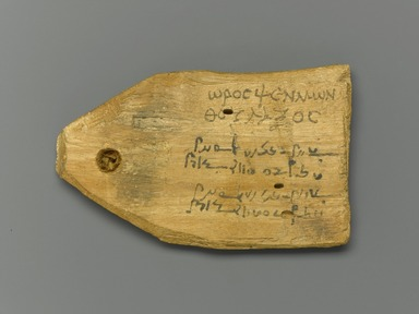 <em>Tag for Mummy of a Stonecutter, with Text in Greek and Demotic</em>, 30 B.C.E.-365 C.E. Wood, ink, 2 7/16 x 4 x 1/2 in. (6.2 x 10.2 x 1.2 cm). Brooklyn Museum, Charles Edwin Wilbour Fund, 37.1395E. Creative Commons-BY (Photo: Brooklyn Museum, 37.1395E_front_PS1.jpg)