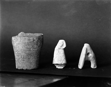 <em>Small Model of a Hoe</em>, ca. 1539-1075 B.C.E. Limestone, 1 5/8 x 3/4 x 2 1/4 in. (4.2 x 1.9 x 5.7 cm). Brooklyn Museum, Charles Edwin Wilbour Fund, 37.247E. Creative Commons-BY (Photo: , 37.143E_37.1344E_37.247E_GRPA_glass_bw.jpg)