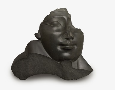 <em>Face and Shoulder from an Anthropoid Sarcophagus</em>, 332-30 B.C.E. Greywacke, 18 1/2 × 20 1/2 × 5 in., 38.5 lb. (47 × 52.1 × 12.7 cm, 17.46kg). Brooklyn Museum, Charles Edwin Wilbour Fund, 37.1516E. Creative Commons-BY (Photo: Brooklyn Museum, 37.1516E_edited_PS9.jpg)