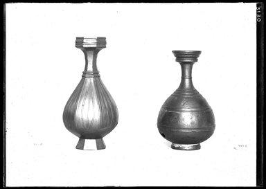 <em>Vase</em>. Bronze, 5 7/8 x 3 3/8 in. (15 x 8.5 cm). Brooklyn Museum, Charles Edwin Wilbour Fund, 37.1541E. Creative Commons-BY (Photo: , 37.1540E_37.1541E_GrpA_SL4.jpg)
