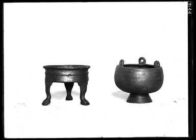 <em>Vase or Bowl with Three Loops for Extension</em>. Bronze, 2 11/16 x 3 9/16 in. (6.8 x 9 cm). Brooklyn Museum, Charles Edwin Wilbour Fund, 37.1551E. Creative Commons-BY (Photo: , 37.1543E_37.1551E_GrpA_SL4.jpg)
