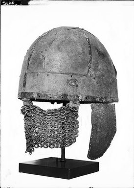 Roman. <em>Helmet</em>, 7th century C.E. Bronze, iron, 11 5/8 x 7 1/16 x Diam. 25 1/16 in. (29.5 x 18 x 63.7 cm). Brooklyn Museum, Charles Edwin Wilbour Fund, 37.1600E. Creative Commons-BY (Photo: Brooklyn Museum, 37.1600E_NegA_bw_SL1.jpg)