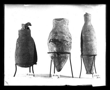 <em>Long Slender Vase</em>, 664-332 B.C.E. Clay, 6 × Diam. 1 9/16 in. (15.2 × 4 cm). Brooklyn Museum, Charles Edwin Wilbour Fund, 37.1703E. Creative Commons-BY (Photo: , 37.1703E_37.1704E_37.1706E_GrpA_SL4.jpg)