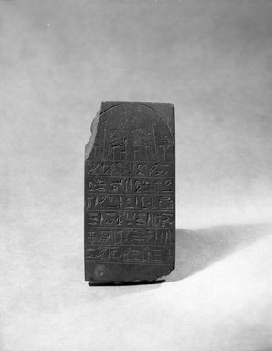 <em>Small Tablet of Nekhtu</em>, 19th century C.E. Slate, 4 1/8 x 2 5/16 in. (10.5 x 5.8 cm). Brooklyn Museum, Charles Edwin Wilbour Fund, 37.1735E. Creative Commons-BY (Photo: Brooklyn Museum, 37.1735E_film_bw.jpg)