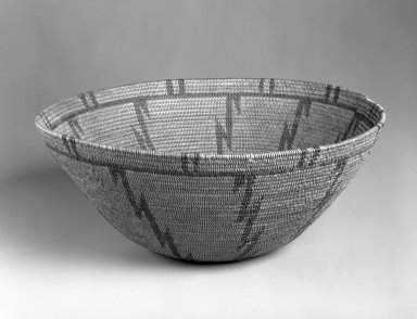 Apache. <em>Coiled Basket with Zig-zag Design</em>, first quarter 20th century. Devil's Claw filament, 12 x 31.7 cm. Brooklyn Museum, Gift of Mrs. Frederic B. Pratt, 37.173. Creative Commons-BY (Photo: Brooklyn Museum, 37.173_bw.jpg)