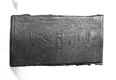 Egyptian. <em>Fragment Inscribed for Taharqa</em>. Bronze, 1 15/16 x 3 7/16 x 5/16 in. (4.9 x 8.7 x 0.8 cm). Brooklyn Museum, Charles Edwin Wilbour Fund, 37.1792E. Creative Commons-BY (Photo: Brooklyn Museum, 37.1792E_NegB_SL4.jpg)
